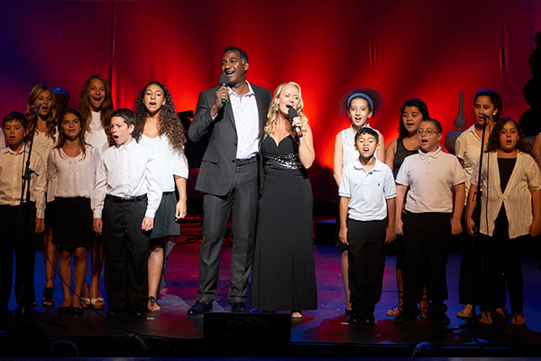 Norm Lewis, Christina Connors and the We Can Be Kind kids choir.