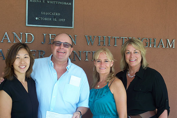 Whittingham Cancer Center receives a check from Unity Center.